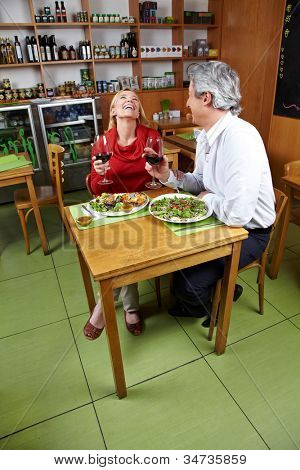 Happy married couple having diner together in a restaurant