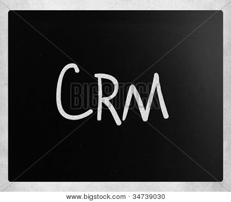 "The Word ""crm"" Handwritten With White Chalk On A Blackboard"
