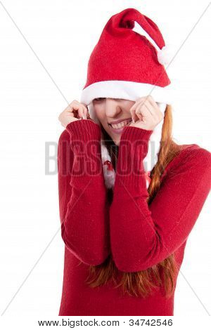 Smiling Young Woman At Christmastime In Red Clothes Isolated
