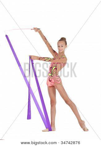 Young Gymnast Performs An Exercise