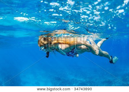Beautiful Woman Snorkeling in Tropical Ocean