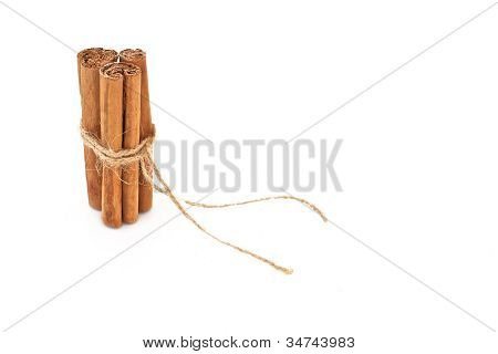 Cinnamon Tied With String And Isolated