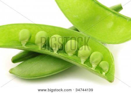bunch of sugar snaps with one opened pod with peas visible on a white background