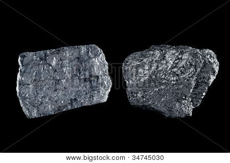 Two chunks of bituminous coal use to generate power isolated on black.