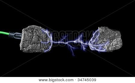 A green extension core plugged into a lump of coal and surging electricity to another piece of coal.