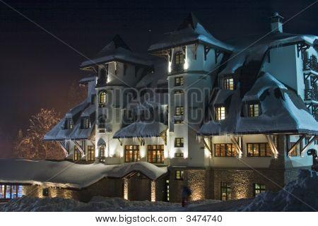 Nightshot Of Snow-Covered Ski-Resort Hotel