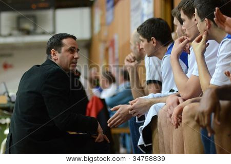 KAPOSVAR, HUNGARY - FEBRUARY 22: Kaposvar players listening to trainer at a Hungarian Cup basketball game with Kaposvar (white) vs. Fehervar (blue) on February 22, 2012 in Kaposvar, Hungary.