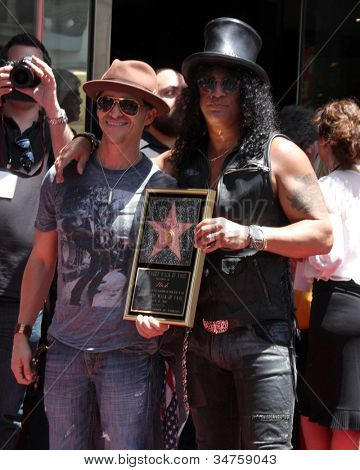LOS ANGELES - JUL 9:  Clifton Collins Jr., Slash at the Hollywood Walk of Fame Ceremony for Slash at Hard Rock Cafe at Hollywood & Highland on July 9, 2012 in Los Angeles, CA