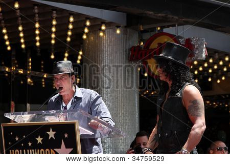 LOS ANGELES - JUL 9:  Charlie Sheen, Slash at the Hollywood Walk of Fame Ceremony for Slash at Hard Rock Cafe at Hollywood & Highland on July 9, 2012 in Los Angeles, CA