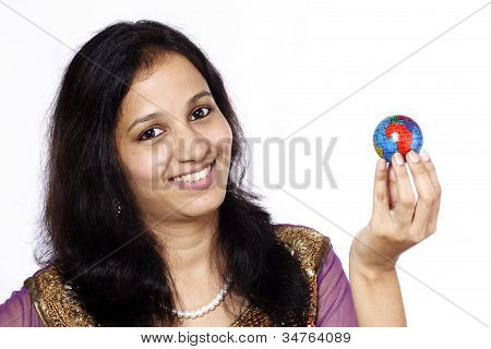 Smiling Young Womal Holding A Globe