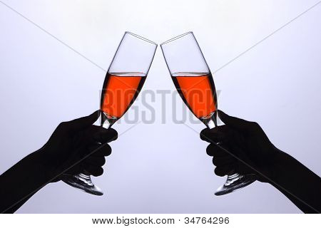 Two Hands With Wine Glasses