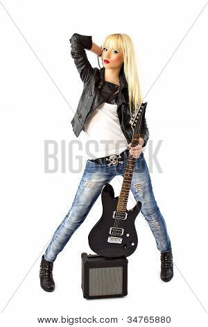 Beautiful Young Woman In Blue Jeans Posing With Black Electric Guitar