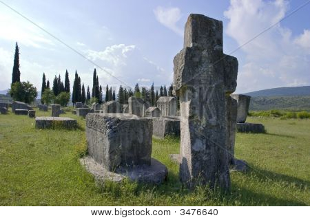 Ancient Tombstones In The Field