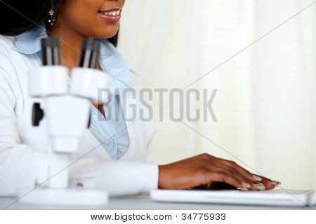 Beautiful Black Young Woman Working At Laboratory