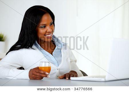 Pretty Young Girl Having Fun On Laptop