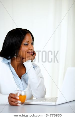 Charming Woman Reading On Laptop Screen