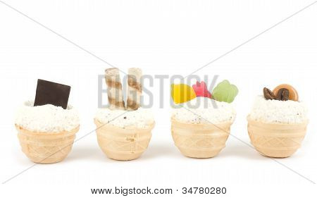 Dessert with a white cream with various ornaments on white background