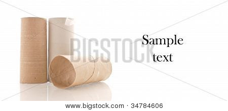 Three Empty Rolls Of Toilet Paper With Space For Custom Text On White