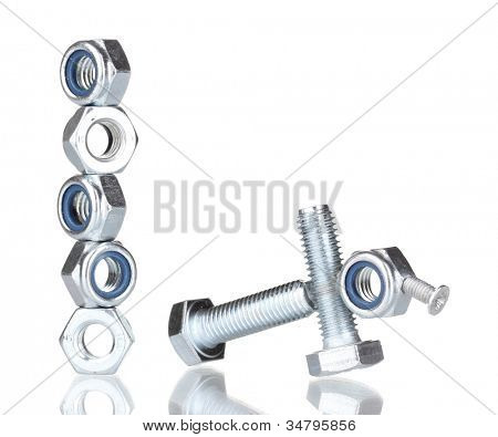 Stacks of balanced screws and screw-nuts isolated on white