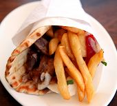 stock photo of souvlaki  - A souvlaki gyros pita kebab Greece - JPG