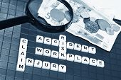 stock photo of workplace accident  - Injury claim concept with key words and cash compensation - JPG