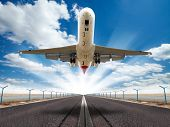 stock photo of off_road  - Big jet plane taking off runway - JPG