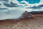 Mudpots In The Geothermal Area Hverir, Iceland. The Area Around The Boiling Mud Is Multicolored And  poster