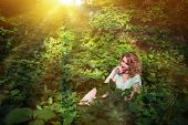 Beautiful Young Romantic Pensive Woman Sits Surrounded By Wild Grapes And Thinks Of Something Agains poster