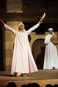 White Robe Sufi Dancer Raised Arms Cairo