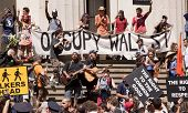 NEW YORK-JULY 11: Occupy Guitarmy protesters rally and play music in front of Federal Hall across fr