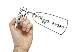 foto of higgs boson  - Hand holding pen drawing a Higgs boson (the god particle) an elusive elementary particle ** Note: Shallow depth of field - JPG
