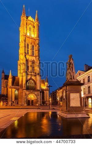 Monument to Jan Frans Willems and Saint Bavo Cathedral in the evening. Sint-Baafsplein, Flanders, Ghent, Belgium