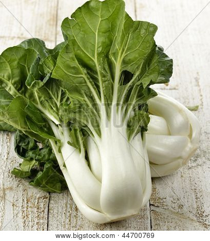 Fresh White Choy Sum Stalks With  Green Leaves ,Close Up