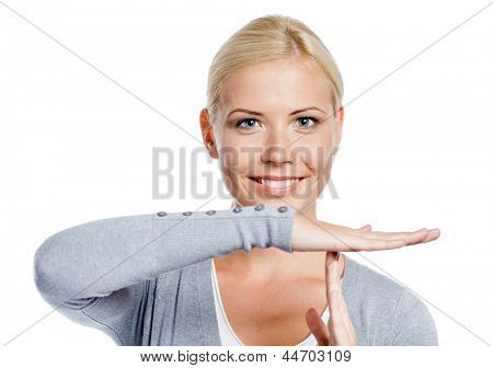 Portrait of woman in gray sweater gesturing time out, isolated on white