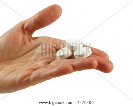 Tablets Lying Upon Hand