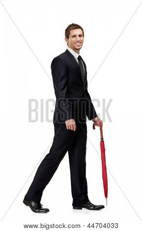 Walking man with closed red umbrella, isolated on white
