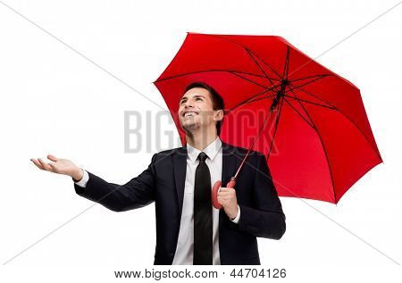 Palming up man with umbrella checks the rain, isolated on white
