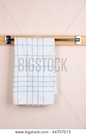 Bath towel on crossbar in room