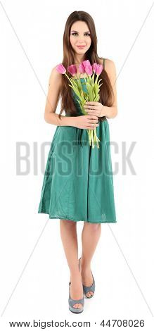 Young beautiful girl in green dress with tulips in her hand, isolated on white