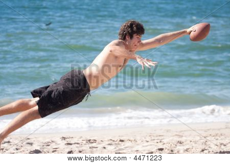 Kid Flying Thru The Air To Catch A Football