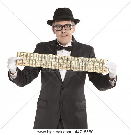 Magician. Happy businessman  with dollars. Isolated over white