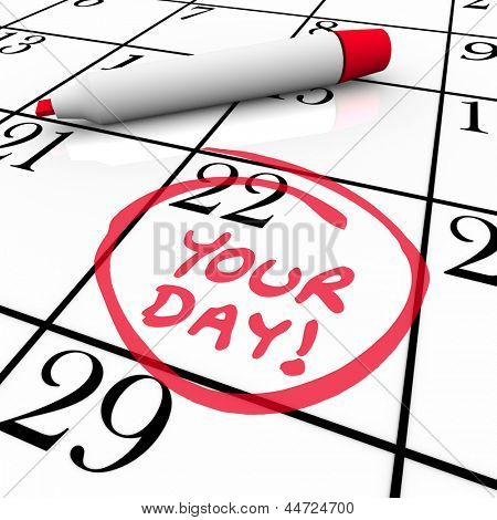 The words Your Day circled on a calendar with a red marker to remind you of a special date, birthday, holiday, vacation, anniversary, milestone or time to relax and take days off