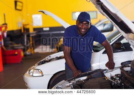 male african car mechanic inside workshop