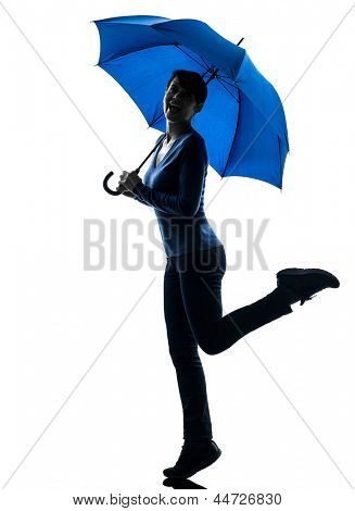 one caucasian woman happy holding umbrella  in silhouette studio isolated on white background