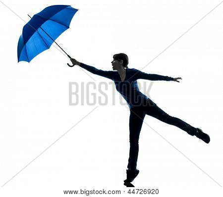 one caucasian woman holding wind blowing  umbrella  in silhouette studio isolated on white background