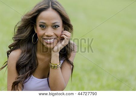 A young female african-american woman enjoying a day at the park
