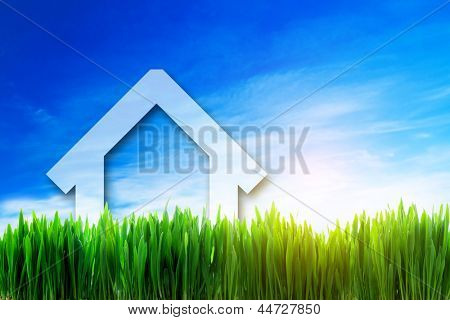 New house perspective on green sunny field. Eco, environment friendly, mortgage investment concepts