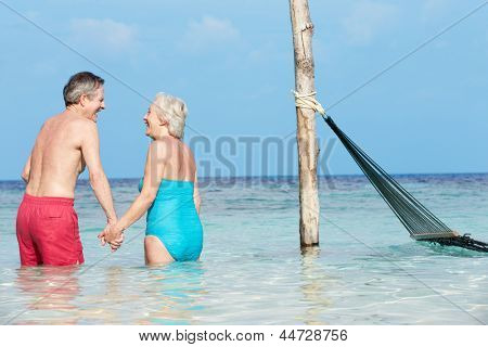 Romantic Senior Couple Standing In Beautiful Tropical Sea