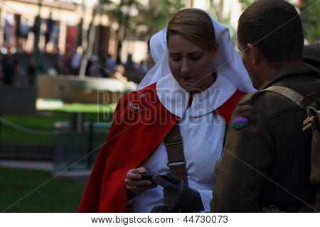 Brisbane, Australia - April 25 : Unidentified World War 2 Reenactors Texting During Anzac Day Commem