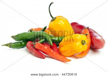 heap of red, orange, green chili peppers and yellow habaneros